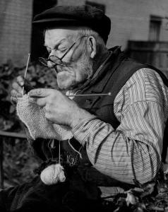 Old man knitting